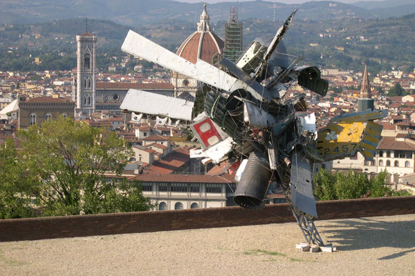 Modern Art at Belvedere  (600Wx400H) - Modern work of Art (a destroyed airplane) at Forte Belvedere. On the background a view of the city (from Forte Belvedere you can enjoy the best view over the Old Town and the hills). (Photo by Marco De La Pierre)