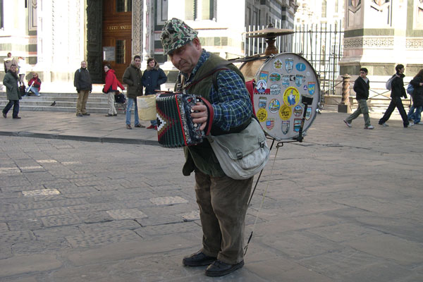 Crazy musician.. (600Wx400H) - A crazy, amazing musician in Piazza del Duomo...(we paid 50 cents for this picture! (Photo by Marco De La Pierre and Breena Kerr)