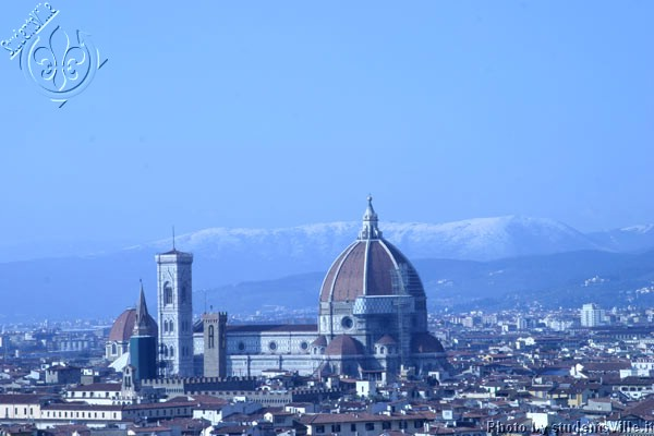 Duomo, winter time (600Wx400H) - February 2004.  Duomo of Florence with snow on the background mountains. (Photo by Marco De La Pierre)