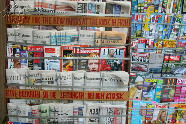 News stand (600Wx400H) - Newspapers in a news stand close to Piazza Repubblica. In the city center of Florence you can find newspapers in 15-20 different languages...(Photo by Marco De La Pierre)