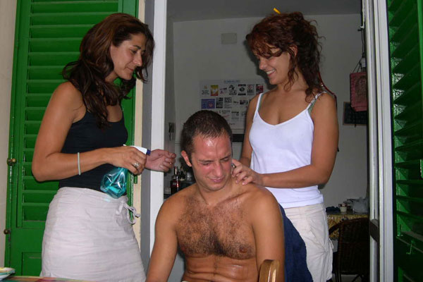 000 (600Wx400H) - Miriam and Marlen from Spain trying to cut the hair of Tommy, a