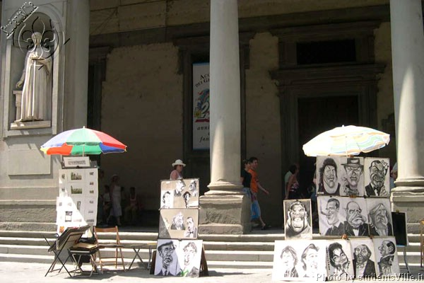 Outside Uffizi (600Wx400H) - Street artist's paintings exposed outside the Uffizi Museum. (Photo by Marco De La Pierre)