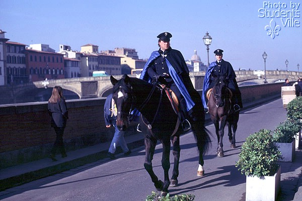Vigili (600Wx400H) - Two 'Vigili' [Police agents of the Municipality of Florence] riding along the River Arno.(Photo by Marco De La Pierre)